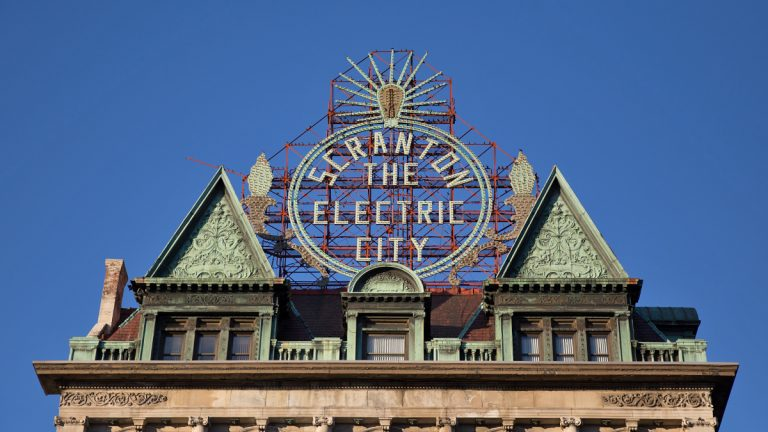 Scranton is known as the 'Electric City' for its early installations of electricity and their electric trolley system. The iconic sign was restored in 2004.  (Lindsay Lazarski/WHYY)