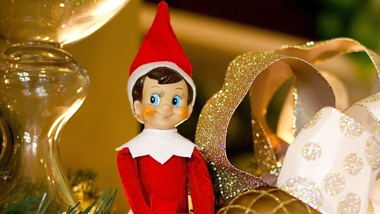 This photo provided by CCB&A, LLC, shows the Elf sitting on the Shelf. There is one hot item this holiday season that won't be resting under the Christmas tree. It will be on a shelf _ watching you. (AP Photo/CCA&B, LLC)