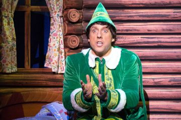 Christopher Sutton as Buddy the Elf in  Walnut Street Theatre's holiday production of