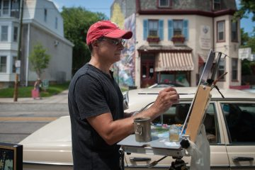 Matt Deprospero, of South Philadelphia, paints the Laurel Hill Gardens on Germantown Avenue during Chestnut Hills' Plein Air event Sunday morning, June 14, 2015. Artists from throughout the region set up outdoors along the avenue to paint the scenes surrounding them.
