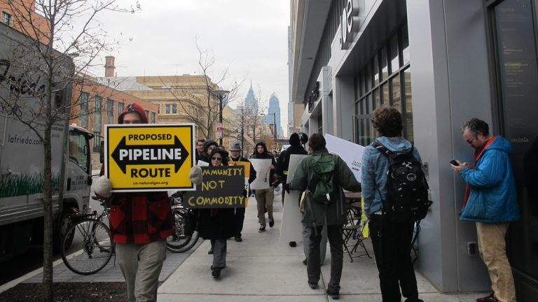 "Dozens of protestors carried signs and chanted ""no fracking hub"" outside Drexel University's Creese Student Center on Dec. 5, where business leaders met to discuss plans for expanding Philadelphia's role in the Marcellus Shale natural gas boom. (Katie Colaneri/StateImpact Pennsylvania)"