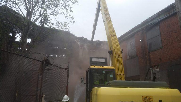 Demolition begins on Hunting Park building Wednesday. (Tom MacDonald/WHYY)