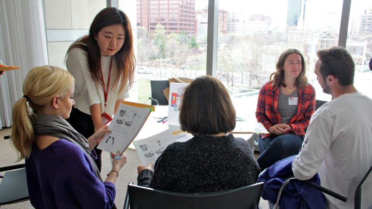 Min Soo Yoo gives her refugee students a feel for an immigrant's English as a second language class by teaching them Korean. (Emma Lee/WHYY)
