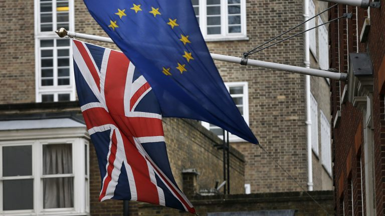 A European Union flag is shown hanging beside the Union Jack at the Europa House in London. (AP Photo/Frank Augstein)