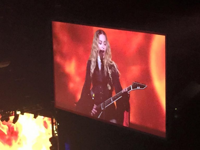 Madonna, on screen, during her Philadelphia concert (Eric Walter/WHYY)