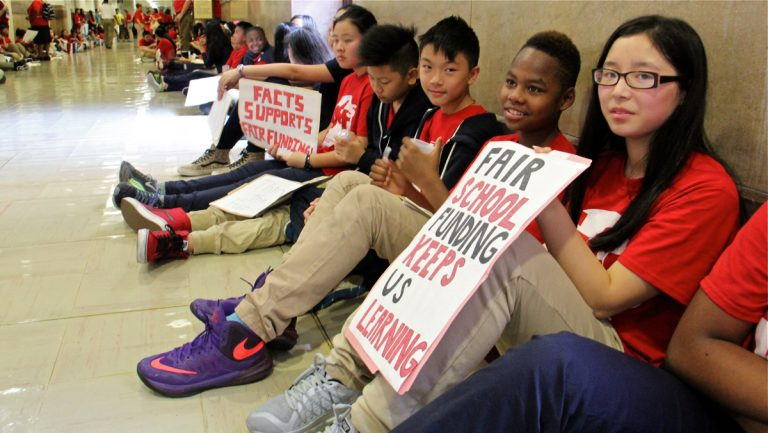 Students from FACTS Charter School fill the halls of City Hall
