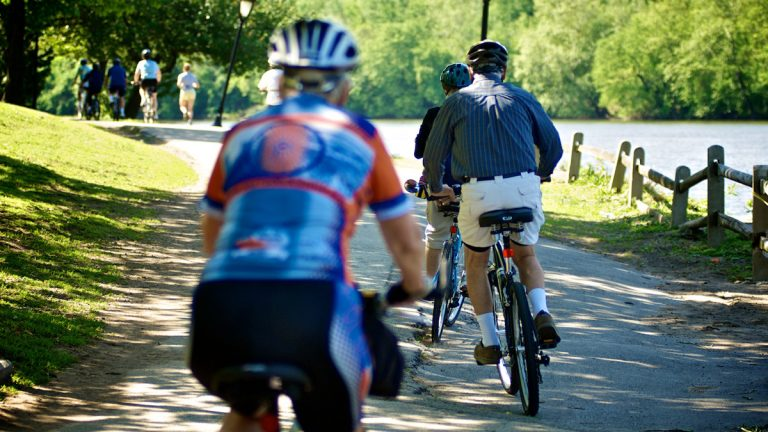 Cyclists are shown on a bike path alongside the Schuykill River. (Bas Slabbers/for NewsWorks, file)
