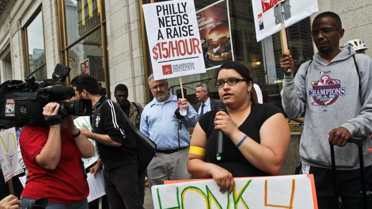 Crystal Lopez, who works at a Dunkin Donuts/Baskin Robbins and says it's impossible to support her sick mother and 11 year-old brother on a minimum wage salary, is shown at a protest outside of a Center City Philadelphia McDonald's demonstrating for a $15/hour minimum wage. (Kimberly Paynter/WHYY)