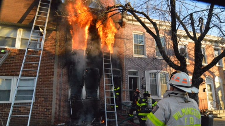 Two young girls were killed as fire ripped through a Wilmington row home on Monroe St. Tuesday afternoon. (John Jankowski/for NewsWorks)