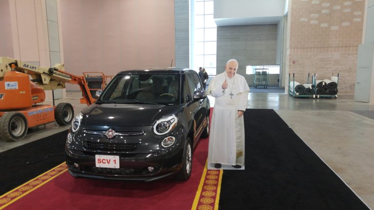 One of the Fiats that ferried Pope Francis around Washington, New York and Philadelphia in September will be up for auction at a Philadelphia Car Show benefit. (Tom MacDonald/WHYY)
