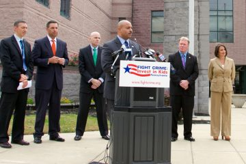 District attorneys from Delaware, Montgomery, Philadelphia, Chester, and Cumberland counties all gathered outside the state correctional facility in Chester to voice their support of expanding pre-K education to more at-risk kids in Philadelphia. (Nathaniel Hamilton/for NewsWorks)