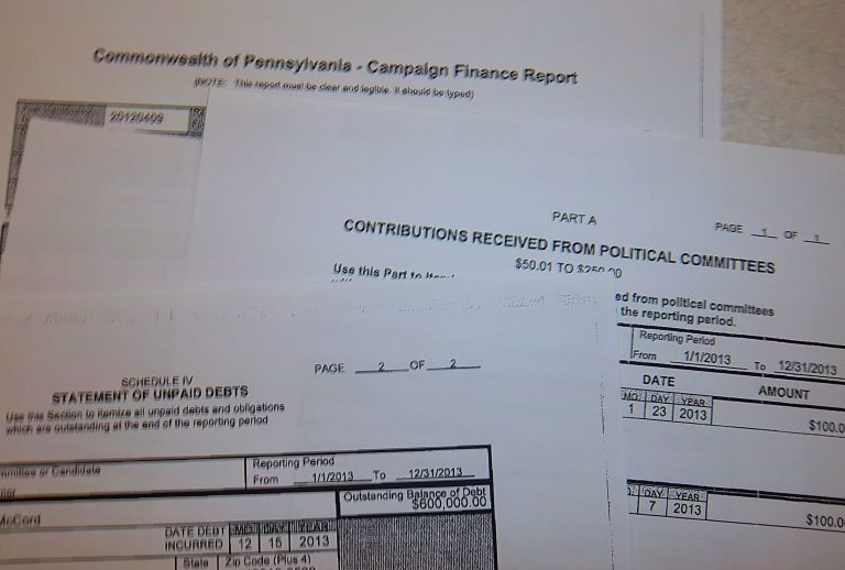 A test for the eyes - finding political donors in PA still often means poring over pages of PDF's or paper reports. (Dave Davies/WHYY)