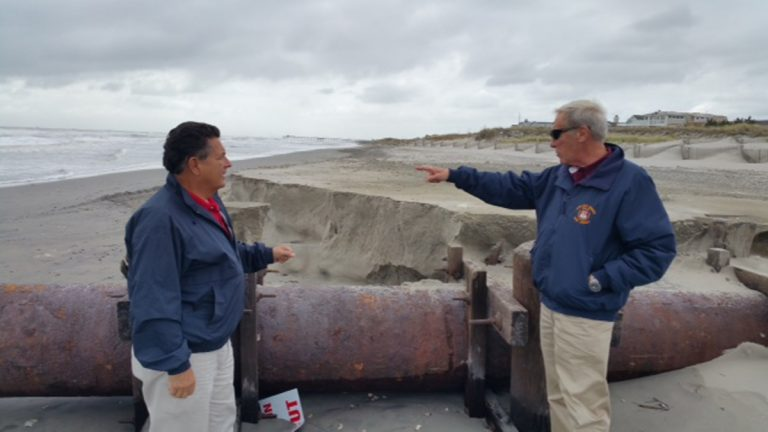 Assemblyman Sam Fiocchi, left, and Cape May County Emergency ManagementCoordinator Martin Pagliughi inspect beach erosion from thenor'easter in Avalon Monday morning. (Phil Gregory/WHYY)