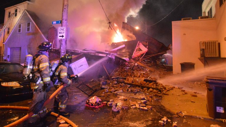 Firefighters work to extinguish the fire on Bird St. in Wilmington. (John Jankowski/for NewsWorks)