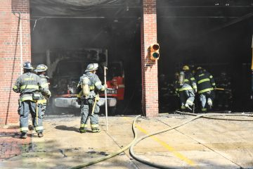 A medic unit caught fire Friday, Sept. 27, 2013 at Fourth and Arch streets where it was stored.  (Kimberly Paynter/WHYY)