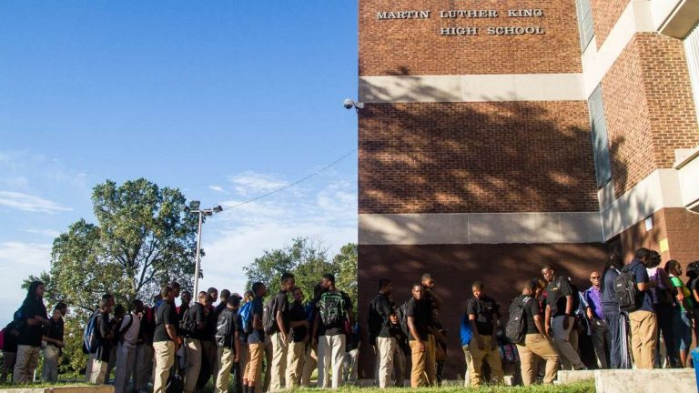 Students file into Martin Luther King High School in West Oak Lane on the first day of school in Sept. (Brad Larrison/for NewsWorks, file)