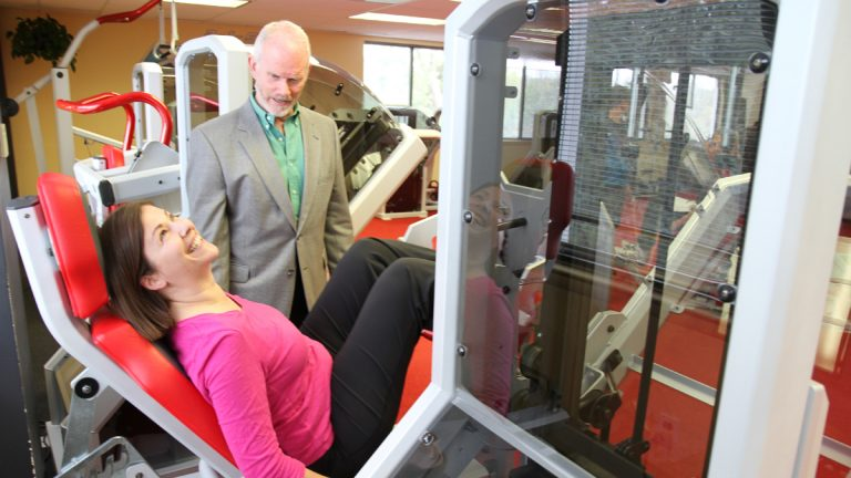 Pulse host Maiken Scott tests out one of the X- force fitness exercises with Dr. Ellington Darden