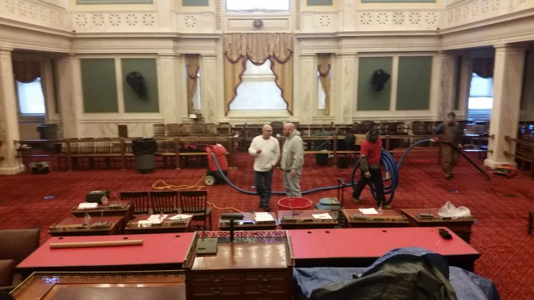 A crew works to clean up Philadelphia City Council chambers. (Tom MacDonald/WHYY)