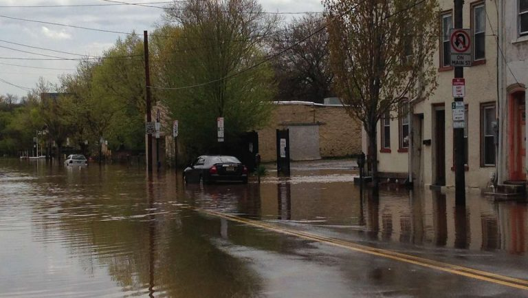 A view of a flooded Main Street on Thursday afternoon. The road was open by Friday, but the job of cleaning up remained. (Neema Roshania/WHYY)
