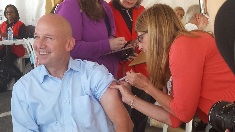 Delaware Governor Jack Markell receiving a flu shot today at the New Castle Farmer's Market (Andrea Gibbs/NewsWorks)
