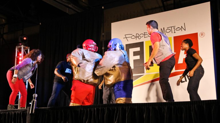 Grover Washington Jr. Middle School teachers Alison Barnes and Gwen Huett don sumo suits to explain basic physics to fifth grade students as part of the