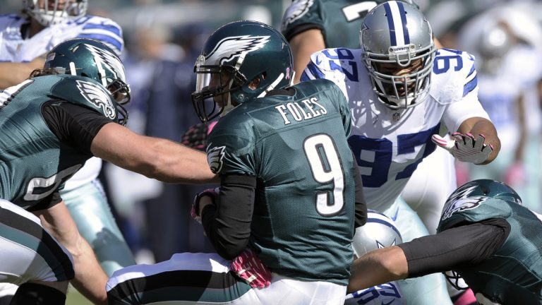 The Eagles hope to avenge the 17-3 lost to the Cowboys in October. Here, QB Nick Foles gets sacked. He left the game with a concussion. (AP Photo/Michael Perez, File)