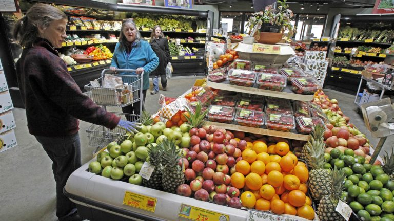 Customers are shown shopping for produce at the Hunger Mountain Co-op in Montpelier, Vt. (AP Photo/Toby Talbot, file)
