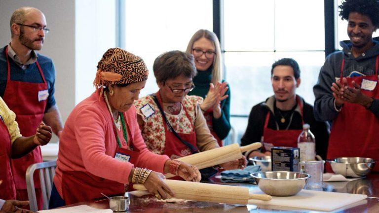 Teela Magar and Cing Neam prepare the roti dough. (Bastiaan Slabbers/for NewsWorks)