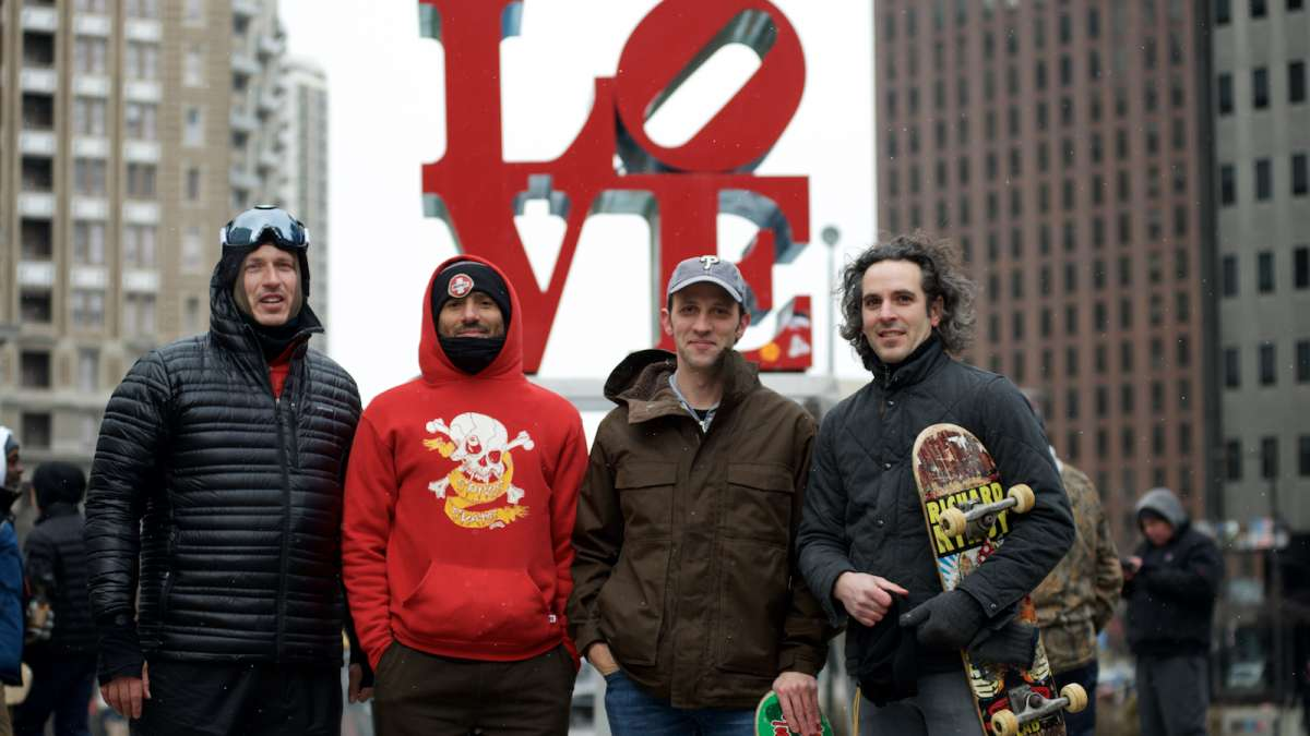 Russell Palermo, Vernon 'Vern' Liard, Jim Franchetti, and Scott Pesiradis stand in front of Robert Indiana's Love Statue.