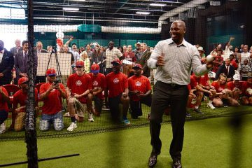 Ryan Howard throws a pitch during the unveiling of the Ryan Howard Training Center on July 20