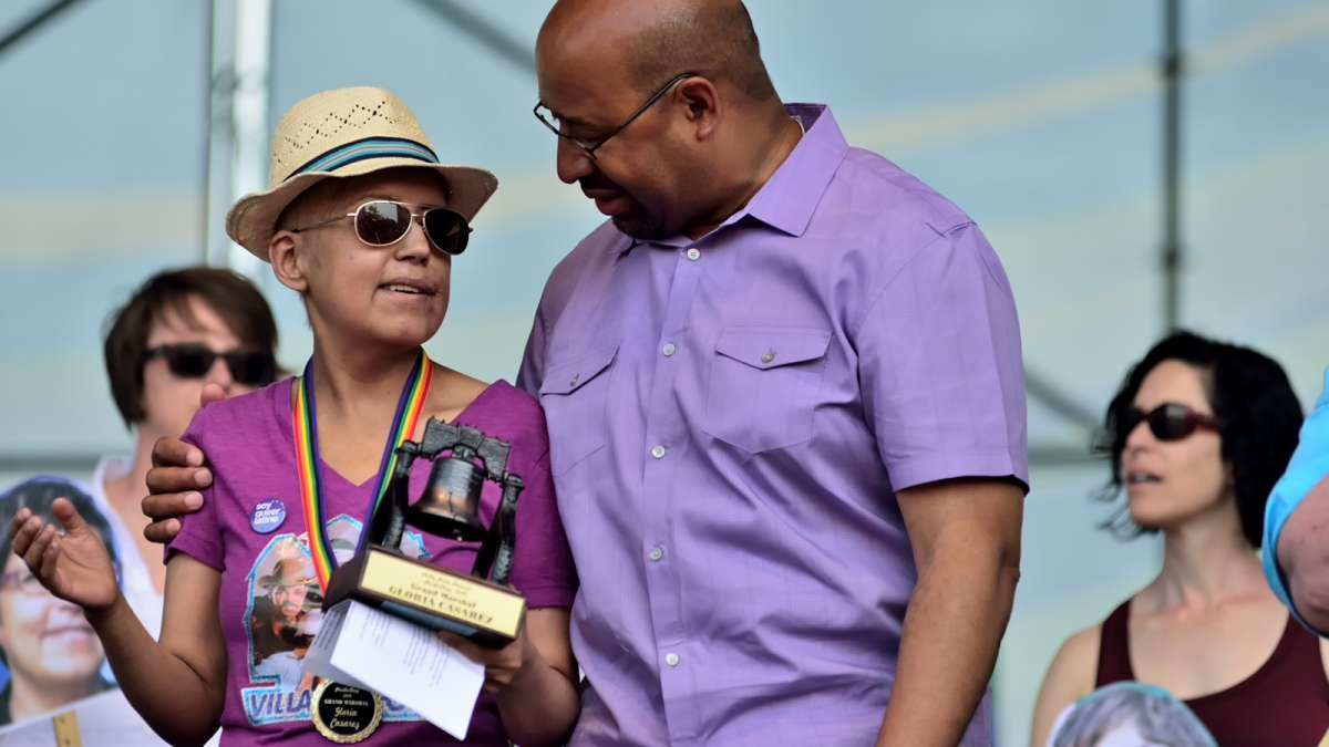 Gloria Casarez is joined on stage by Mayor Michael Nutter at the Philadelphia Pride Parade in June. (Bas Slabbers/for NewsWorks)