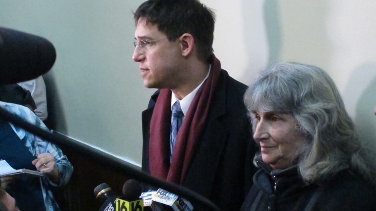 Anti-fracking activist Vera Scroggins, center, and her attorney Scott Michelman, left, speak to the media after a hearing in Montrose, Pa. Last fall, a judge signed off on an order barring Scroggins from more than 300 square miles of Susquehanna County or all the land owned or leased by Cabot Oil and Gas. (Katie Colaneri/for StateImpact)