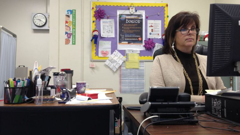 Fran Avena (above) works from her office at Warner Elementary School. The posters behind her come from the Smart Moves