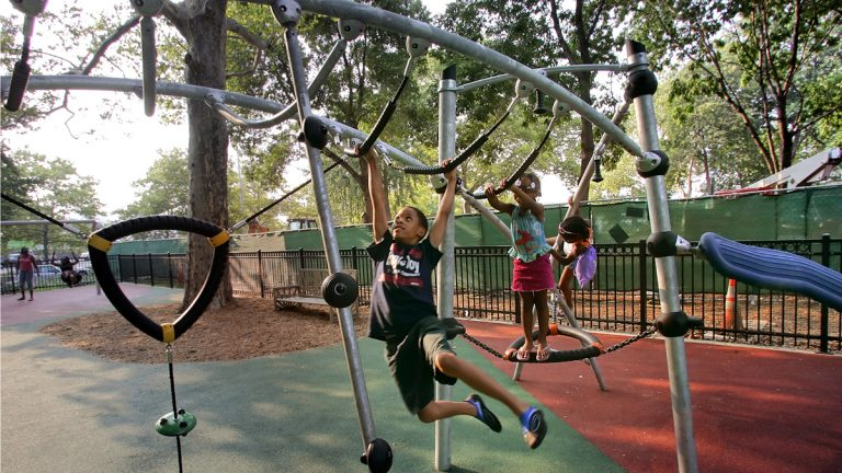 Children play on playground equipment at Franklin Square in Philadelphia, Pa. Our partners over at PlanPhilly are celebrating what would have been Jane Jacobs' 100th birthday this weekend with Jane's Walk 2016. (AP File Photo/George Widman)