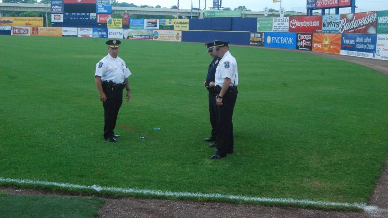 Wilmington Police investigate on the field at Frawley Stadium. (John Jankowski/for NewsWorks)