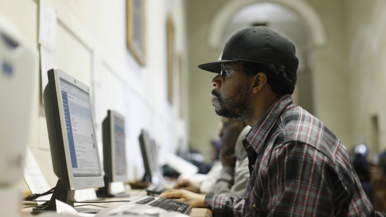 A patron is shown at the  central branch of the Free Library of Philadelphia . (AP Photo/Matt Rourke