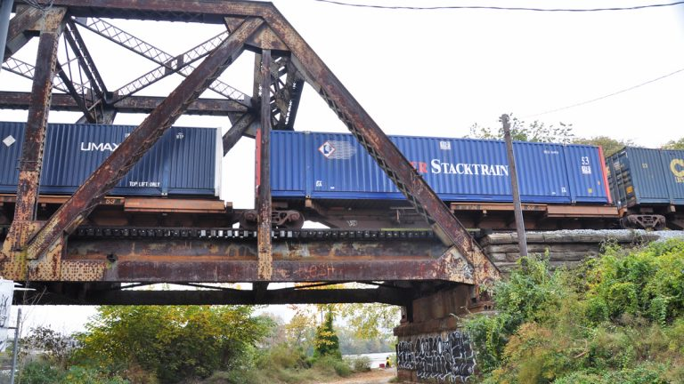 A freight train crosses a bridge in south Philadelphia.  (PlanPhilly file image)