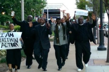 The Rev. Mark Tyler from Mother Bethel AME and other clergy members march in support of and pray for peace in Ferguson. (Image courtesy of POWER)