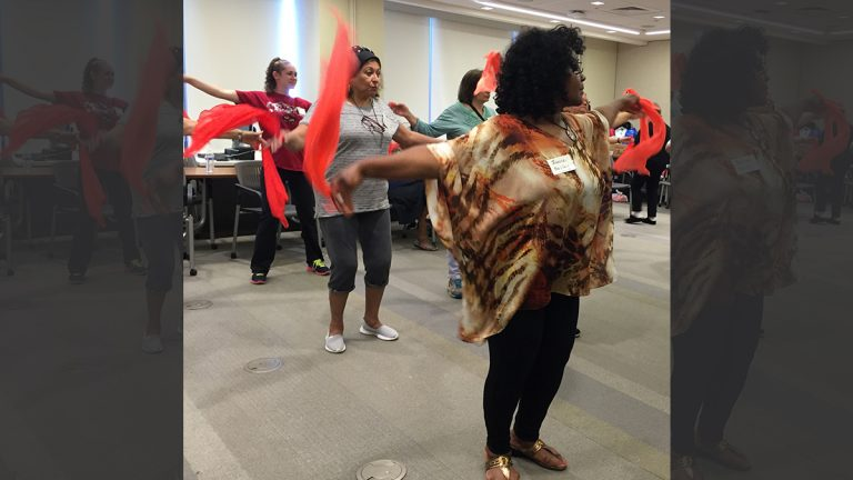 Women attending Camp Discovery learn Bollywood dance moves. The women