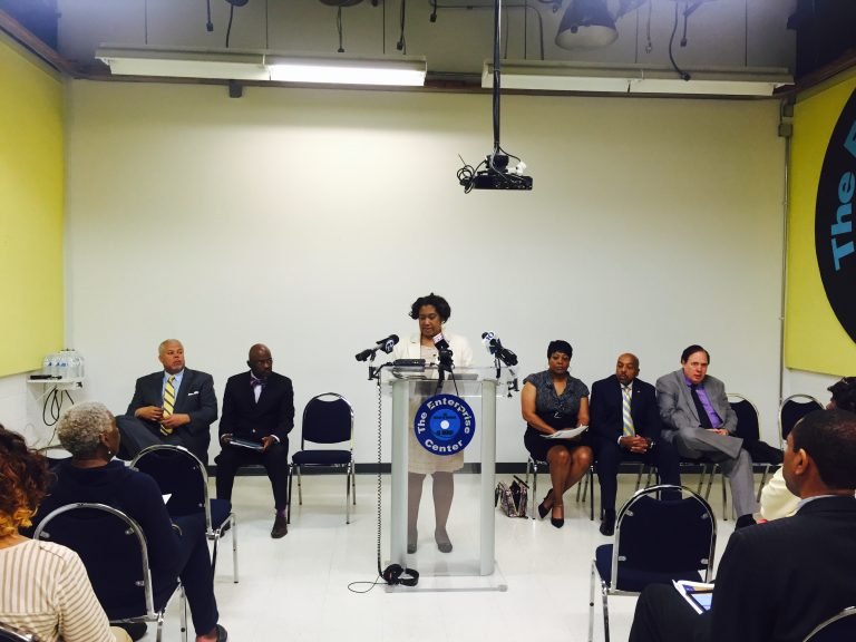 State Rep. Vanessa Lowery Brown, at the lectern, and other community leaders meet for a Monday news conference organized by the Coalition for Life Equality. (Bobby Allyn/WHYY)