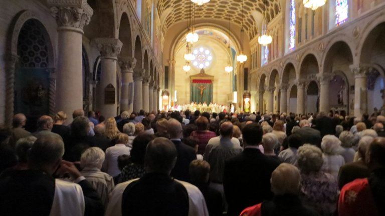 Hundreds pack into a Wilmington church to pay their last respects to Father Balducelli.(Tre Bracey/for NewsWorks)