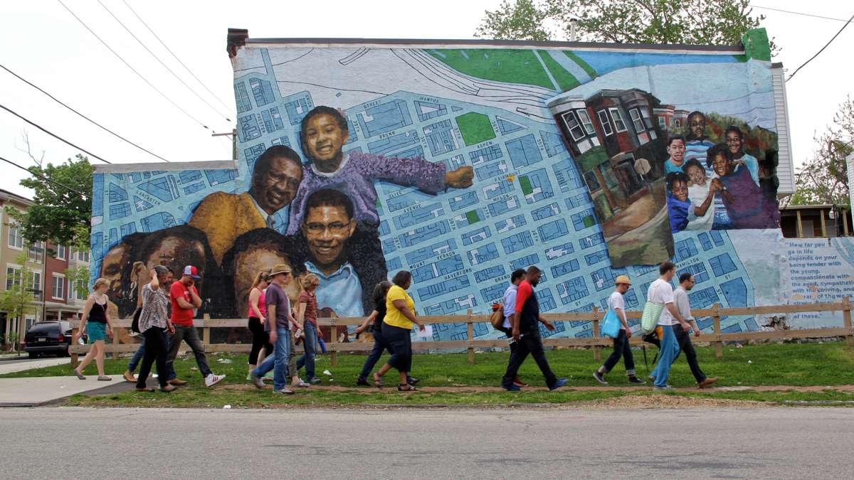 public safety trust depend on work of police and community both  a mural is shown in philadelphia s mantua neighborhood at fairmount avenue and 34th street