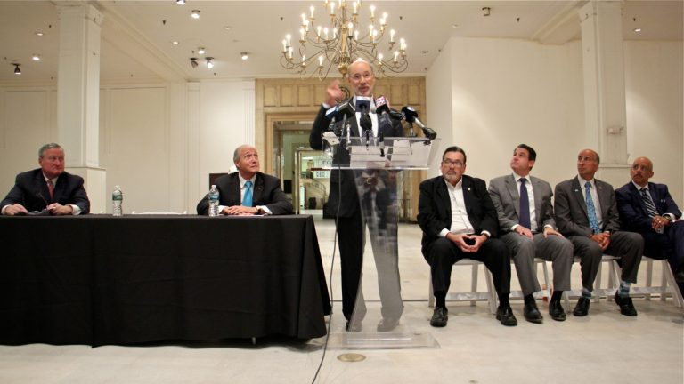 Pennsylvania Gov. Tom Wolf announces a $10 million state redevelopment grant for the Gallery mall in Center City. Wolf is flanked by state and local elected officials and Joe Coradino (second from left) chief executive of Pennsylvania Real Estate Inventment Trust (PREIT) which owns the mall. (Emma Lee/WHYY)