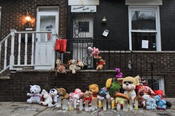 A memorial for Nasir Slaughter, a 17 year-old who was gunned down in August, 2013, is shown. He was killed over a neighborhood dispute. (Kimberly Paynter/WHYY)