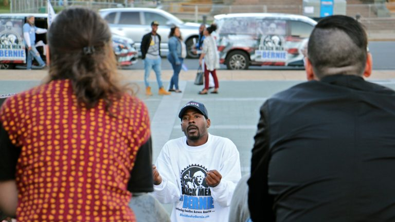 Gary Frazier of  Black Men for Bernie speaks to Bernie Sanders supporters during a meeting on the steps of the Philadelphia Museum of Art. (Emma Lee/WHYY)