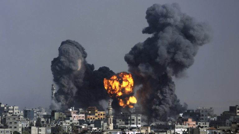 Smoke and fire from the explosion of an Israeli strike rise over Gaza City on Tuesday. Disagreement over whether to lift the Gaza blockade is a key stumbling block to ending more than two weeks of fighting between the Islamic militant Hamas and Israel. (AP Photo/Hatem Moussa)