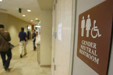 A sign marks the entrance to a gender-neutral restroom at the University of Vermont in Burlington, Vt. (AP Photo/Toby Talbot, file)