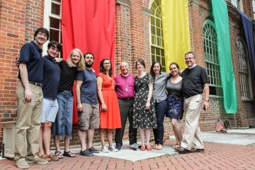 Members of the Christ Church community pose with Bishop Gene Robinson before an interfaith ceremony in July. The author stands at the far left. (Kimberly Paynter/WHYY, file)