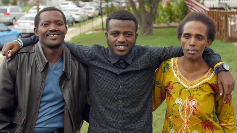 Gentil Ndizihiwe is shown with his parents. (Image courtesy of JEVS Human Services)