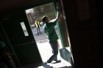 Volunteers cleaning up the Germantown Boys and Girls club last year. (Tracie Van Auken/for NewsWorks, file)
